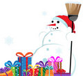 Snowman in a red Santa Hat with a broom Stock Photo