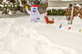 Snowman and reindeer yard decorations abominable red nosed large multi colored lights add color happiness to a snow covered for Royalty Free Stock Photos