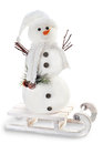 Snowman on sled  on white background Royalty Free Stock Image