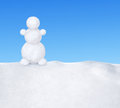 Snowman on snow against the blue sky Stock Photos