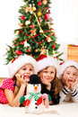 A snowman and three kids Stock Photos