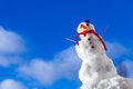 Snowman with toothpick outdoor winter season little happy christmas in blue screw top as hat red scarf and seasonal specific blue Stock Photos
