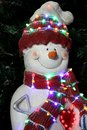 Snowman winter decoration with colourful lights Royalty Free Stock Photos