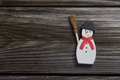 Snowman on wooden background for christmas decoration. Royalty Free Stock Photo