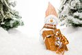 Snowmans gift station a snowman is waiting for somebody to pick up the christmas present in a deep snow covered scenery Royalty Free Stock Image