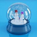 Snowmans in a snowglobe Royalty Free Stock Image