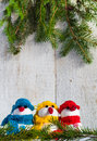 Snowmen board wooden christmas winter plush trio soft on white background Stock Photography