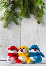 Snowmen board wooden christmas winter plush trio soft on white background Stock Image