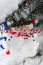 Snowmen christmas ornament hanging snow covered spruce tree outside Stock Photo