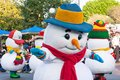 Snowmen in disneyland parade several snow people scurry along s a christmas fantasy snowman has a carrot nose wears a hat mittens Stock Photos