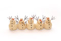 Snowmen five standing in a row with arms spread Royalty Free Stock Photo