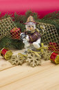 Snowmen pine branches and toys on a wooden table Stock Images