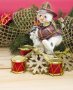 Snowmen pine branches and toys on wooden table Royalty Free Stock Photos