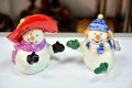 Snowmen porcelain man and woman set for spices Stock Photos