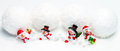Snowmen and snowballs in the snow Royalty Free Stock Photos