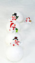 Snowmen and snowballs in the snow Royalty Free Stock Photo