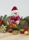 Snowmen and toys holiday background with pine branches Stock Images
