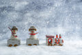 Snowmen in train funny with snowfall Stock Image