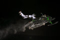 Snowmobile jump extreme jumping during night competitions at buttermilk resort in aspen colorado Stock Images