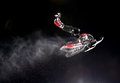 Snowmobile jump extreme jumping during night competitions at buttermilk resort in aspen colorado Royalty Free Stock Photography