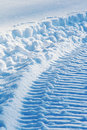 Snowmobile track on snow Royalty Free Stock Photo