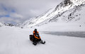 The  snowmobile and woman in the mountains Royalty Free Stock Photo