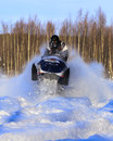 Snowmobiling in swirling snow a snowmobile Royalty Free Stock Photography