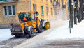 The snowplow clears away the street. Royalty Free Stock Photo