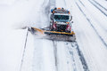 Snowplow removing the snow from the highway during a snowstorm truck cold winter day Royalty Free Stock Photography