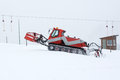 Snowplow working on a ski slope Royalty Free Stock Images