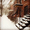 Snowstorm in montreal sudden red brick buildings with staircases covered by snow photo taken with iphone Stock Photo