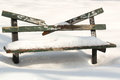 Snowy bench snow covered and broken Royalty Free Stock Photos