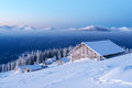 Snowy cabin in the winter mountains Royalty Free Stock Photo