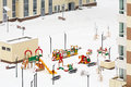 Snowy children playground between houses Royalty Free Stock Photos