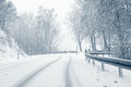 Snowy curvy country road sudden and heavy snowfall on a Royalty Free Stock Photos