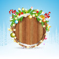 Snowy fir tree branch cones and presents on round wood border winter christmas background forest Royalty Free Stock Photography