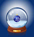 Snowy glass ball Royalty Free Stock Photo