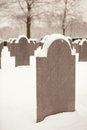 Snowy graves standing in a cold winter cemetery Royalty Free Stock Photos