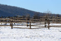 Snowy horse ranch fence and snow filled corral Royalty Free Stock Photo