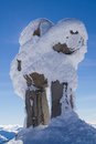 Snowy inukshuk a at the summit of whistler mountain on a sunny day in the winter season Stock Photos