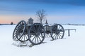 Snowy landscape manassas national civil war battlefield of antique wagon on henry hill at the park in virginia at sunset Stock Photo