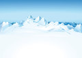 Snowy mountain range scenic view of white with blue sky background Stock Image