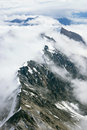 Snowy mountain ridges in clouds kluane national park yukon the as seen from the air Royalty Free Stock Photos