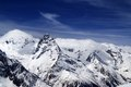 Snowy mountains and blue sky with clouds caucasus mt belalakaya view from ski resort dombay Stock Photography