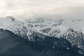 Snowy mountains in cloudy day Stock Photo