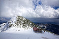 Snowy mountains mountain cabin in on cloudy day in cold winter Stock Photos