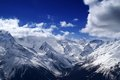 Snowy mountains at nice day caucasus view from ski resort dombay Stock Photos
