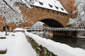 Snowy Nuremberg, Germany- iron bridge ( Kettensteg), old town city walls Royalty Free Stock Photo