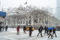 Snowy ny commute commuters deal with the public library during winter storm janus on january in manhattan Royalty Free Stock Photo