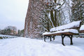 Snowy park scenery with empy bench Stock Photography